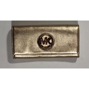Michael Kors wallet gold. Excellent used.